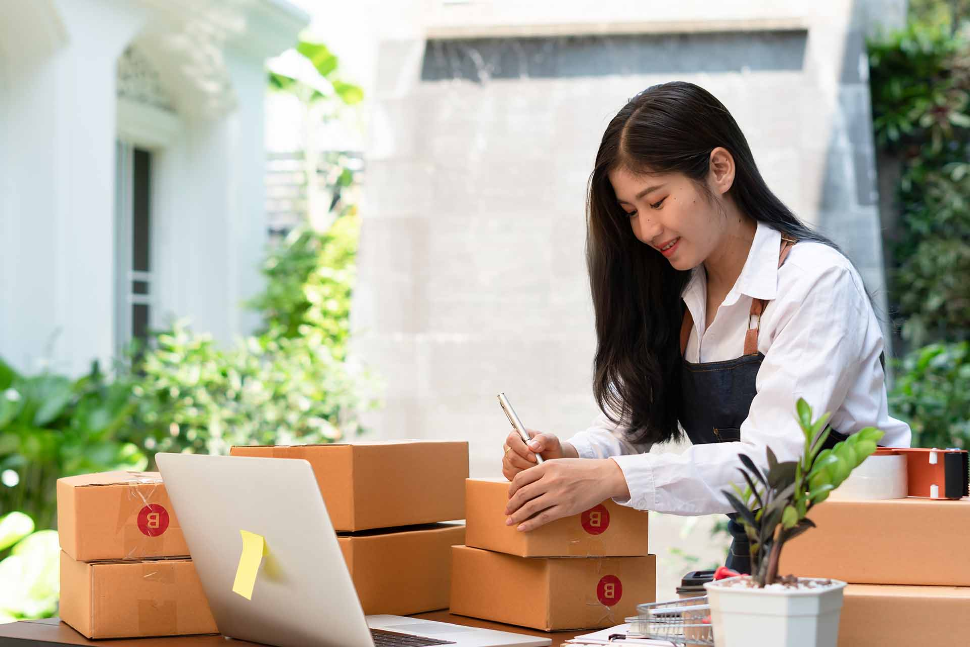 woman store making packages